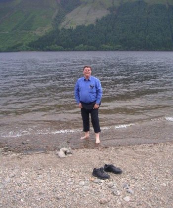 Cook standing in Loch Ness