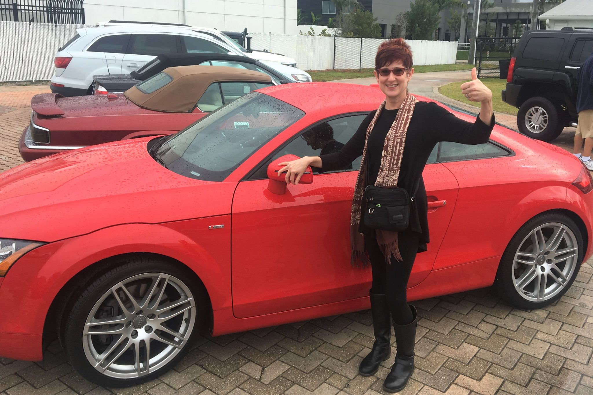 Dunzik-Gougar with her red Audi 6-speed sports car